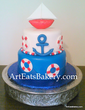 Two tier white blue and red boy s baby shower cake with lifesavers