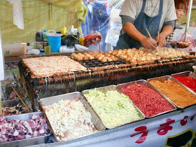 Some of the food just outside Hozomon Gate at Sensoji Temple for Hagoita Ichi