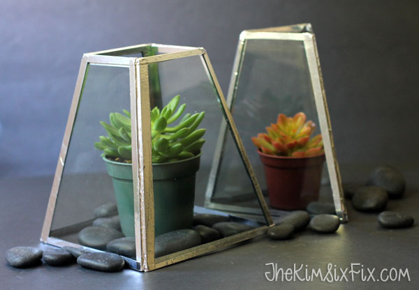 An 80s Brass and Plate Glass Chandelier gets a makeover. See the before and after on how to transform a dated light fixture into a West Elm inspired terrarium.