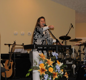 Susan preaching under the anointing at WOPAC.