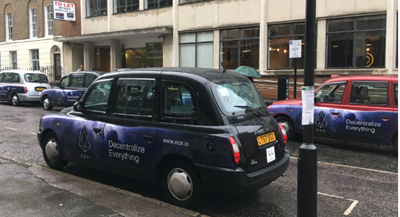 Cryptocurrency advertisements using Taxis on the streets of London