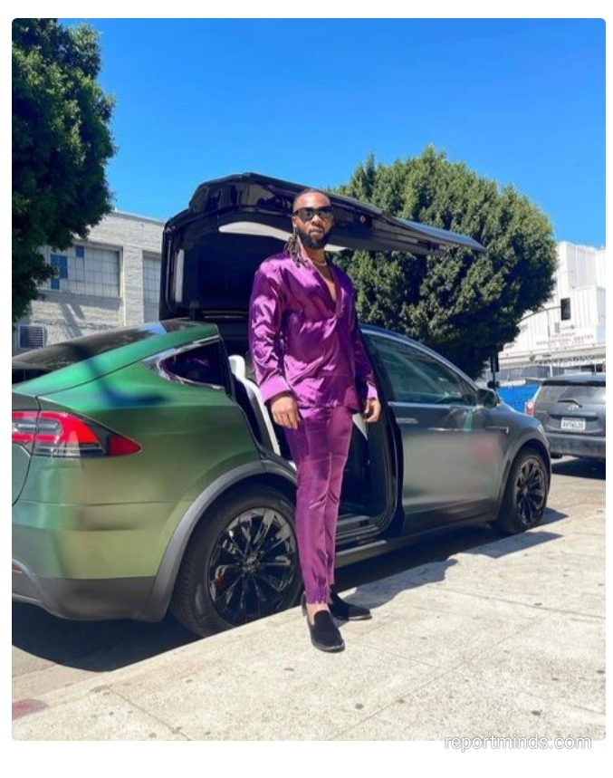 Singer Flavour flaunts his luxurious ride with Lamborghini doors while holidaying in USA (Photos)