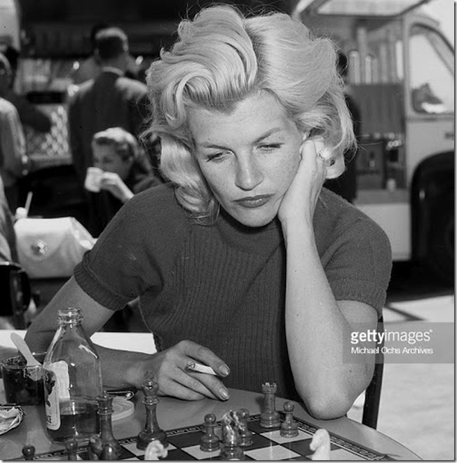 Corinne Calvet plays chess at the Cocoanut Grove in Los Angeles, California,  APRIL 26, 1957