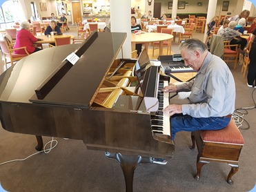 Roy Steen playing the Schimmel grand piano