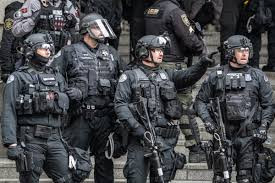 50 highly trained police officers resign after their colleague is found guilty of assaulting a photographer during riot