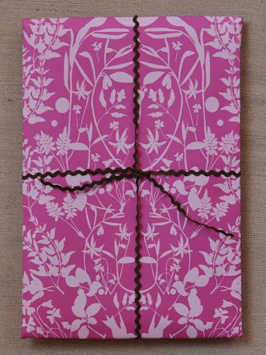 Banquet's vine gift wrap is almost to pretty to open. http://shop.banquetworkshop.com/product/pink-on-pink-gift-wrap-vines