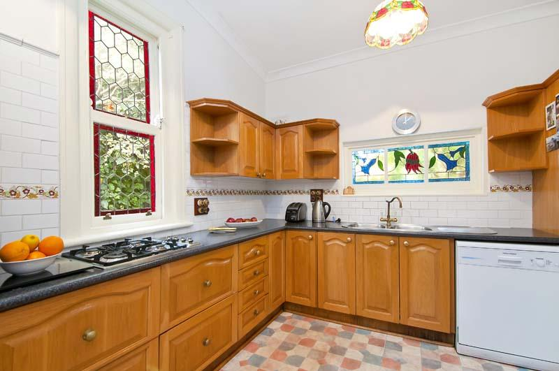 Beautiful Australian design in a very decorative leadlight window. A timber kitchen is sympathetic to Federation style.