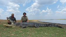 2 happy hunters with 1 big crocodile, harvested with Australia Wide Safaris. Same croc as previous photo, I just needed a photo with me in there!