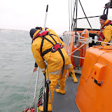 Poole lifeboat crew members guiding the casualty into the Jason's Cradle on exercise on Sunday 20 January 2013 Photo: RNLI Poole/Dave Riley
