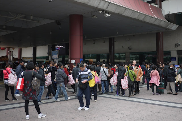 numerous cigarette buyers at the exit of the Macau border control building in Zhuhai, China