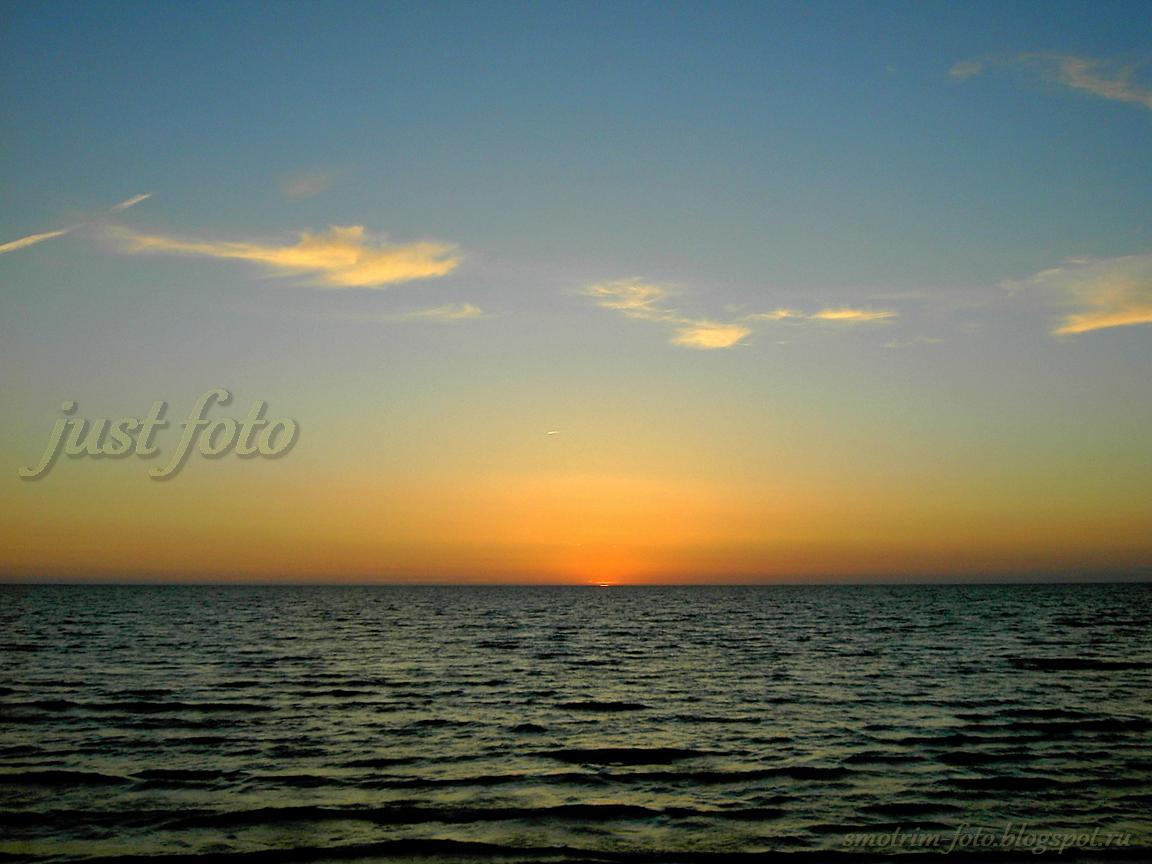 солнце закат озеро вода небо фото