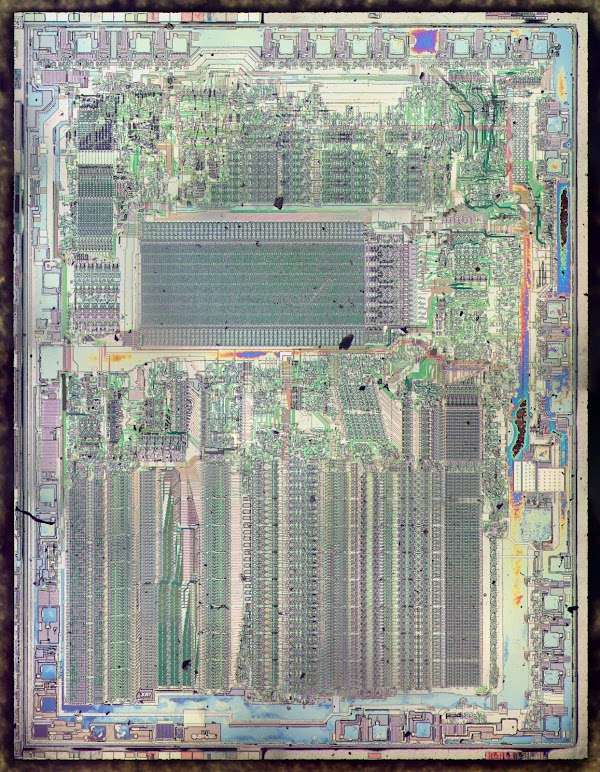 Die photo of the Intel 8087 floating point unit. The metal layer has been stripped off with acid, revealing the polysilicon and silicon underneath.