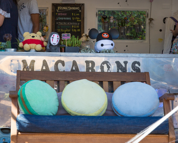 photo of a bench with macaron pillows