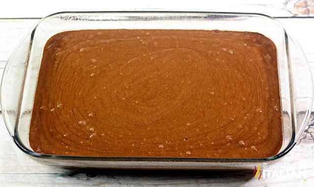 chocolate mint poke cake in a glass pan