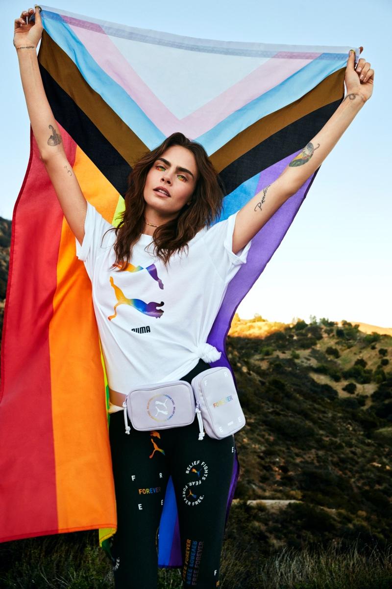 Posing with the LBTQIA+ flag, Cara Delevingne fronts PUMA Pride 2021 campaign.