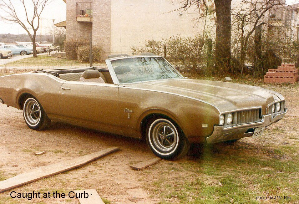 Caught at the Curb: A Couple of Cutlass\'s
