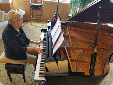 Kay Boyes playing the Kohler Grand Piano