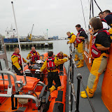 Poole inshore and all-weather lifeboat crew discussing the incident of a motor vessel adrift in Poole Harbour 27 September 2014 Photo: RNLI Poole/Rob Inett
