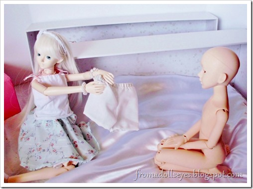 Dressing the new doll.