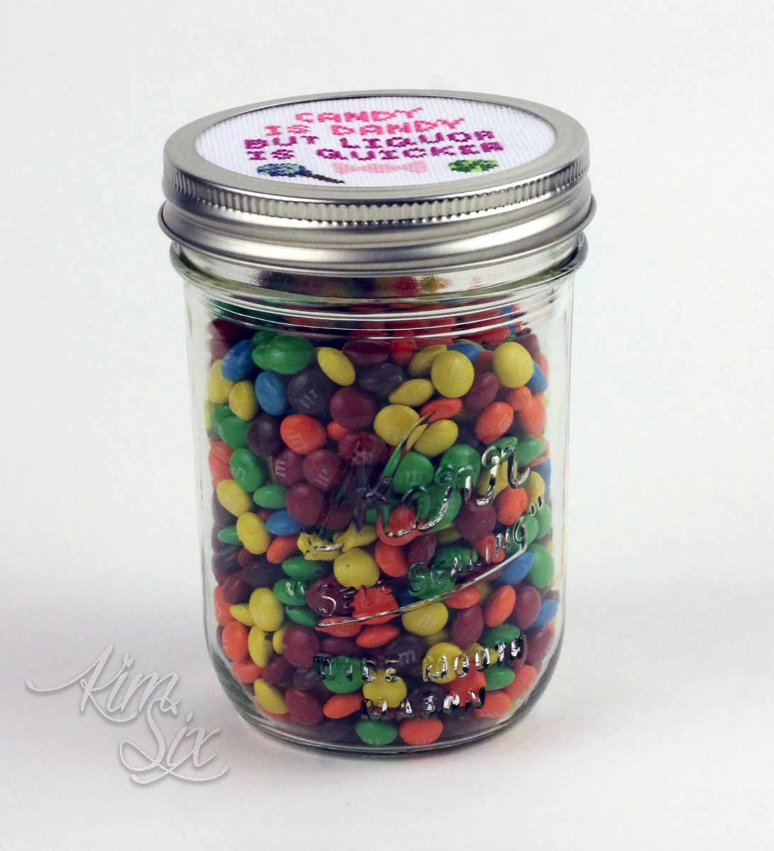 Cross stitched candy mason jar