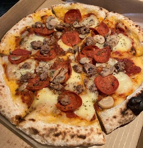 A box of Italian Sausage and Pepperoni with Mushrooms pizza from Rodolfo Pizzeria
