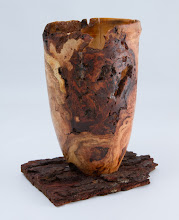 "Photo: RICHARD WEBSTER – 7.5"" x 7"" – Hollow Vessel, mounted on a piece of bark  [Cherry Burl]"