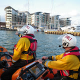 Poole ILB Helmsman Glen Mallen and Crew Member Steve Porter checking the space available to bring Dolphin III alongside the quay during a training exercise - 22 April 2014 Photo: RNLI Poole/Anne Millman