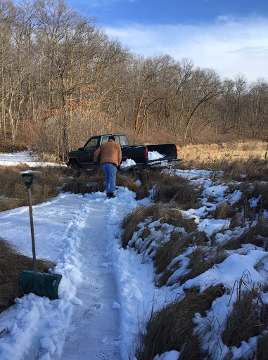 Harvesting snow from the pond to bring to the trail