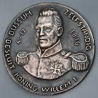 Achterkant bronzen penning Bussum zelfstandig