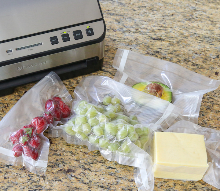 photo of fruit, cheese, and avocado in vacuum sealed bags