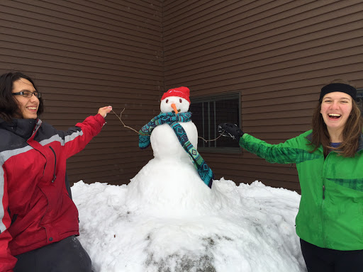 Maplelag staffers Juan and Helen after a freshly made snowman!