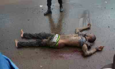 Panic as image of a lady appears beside corpse of man knocked down by a car in Enugu State! (Photos)