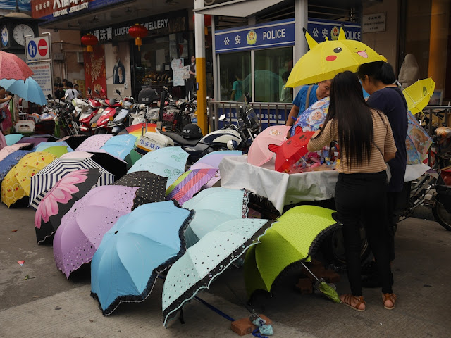 people buying umbrellas in Zhongshan, Guangdong