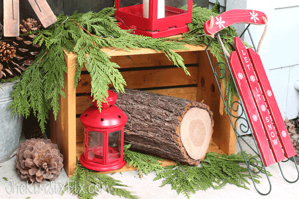Simple rustic front porch with red sled