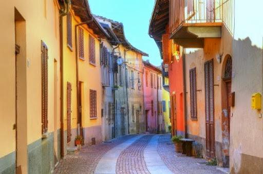 11962906-narrow-paved-street-.jpg