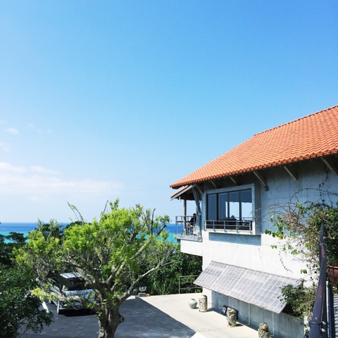 blue skies and ocean and cafe doka doka okinawa