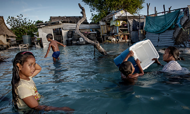 The people of Kiribati are under pressure to relocate due to sea level rise. New Zealand could introduce a visa to help relocate people affected by climate change. Photo: Jonas Gratzer / LightRocket / Getty Images