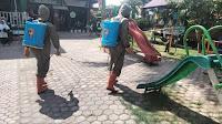 Brimob Polda Aceh Semprot Disinfektan Lembaga Pendidikan