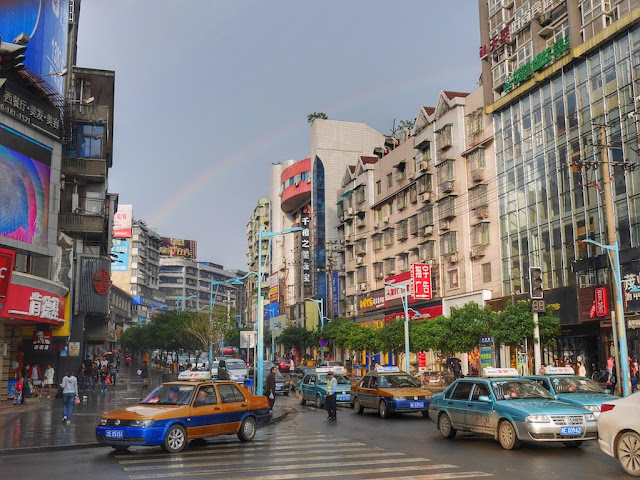 rainbow over a street scene in Shaoyang, Hunan