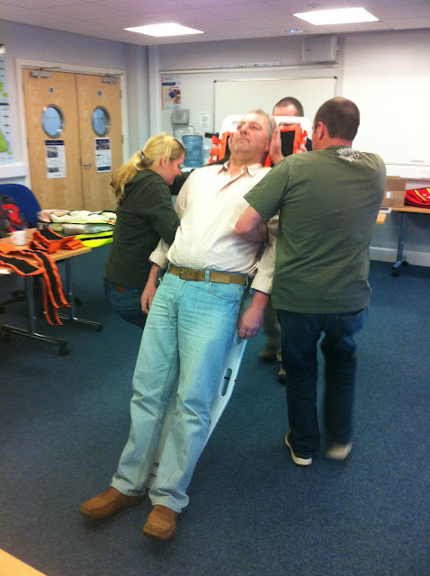 Casualty Care for Lifeboat Crew course – April 2011: crew using a rapid take-down technique with a spine board