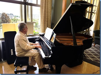 Jim Nicholson playing the K. Kawai grand piano.