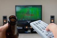 Butelka piwa, pilot i telewizor