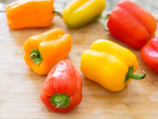 photo of red, yellow, and orange bell peppers