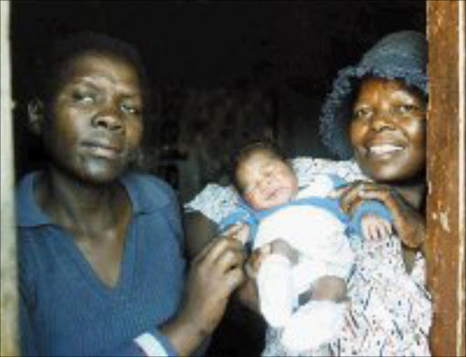 EARLY BLOOMER: Inspector Patricia Malindi, Sophie Mgcina and newborn Palesa at the Evaton police station. Pic. Len Kumalo. © Sowetan.