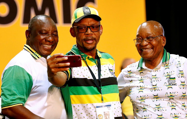 All smiles: Newly elected president of the ANC Cyril Ramaphosa, left, with outgoing ANC president Jacob Zuma, right, and outgoing national executive committee member Pule Mabe during the party's national conference this week. Picture: REUTERS