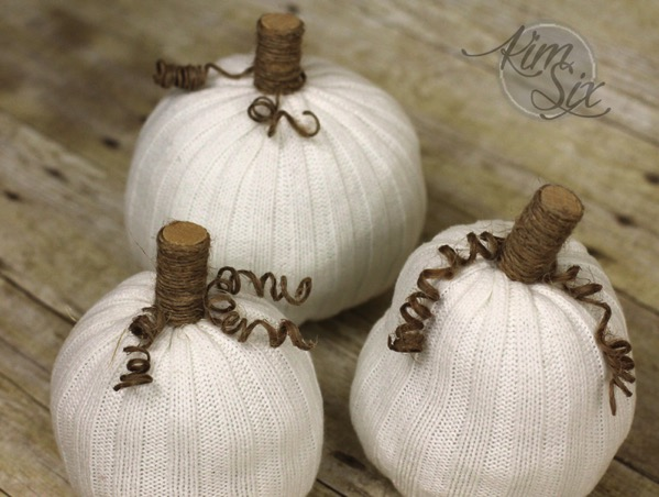Three little white sweater pumpkins