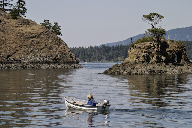 A local navigates her boat through the inlets and tiny islands of the Chuckanuts.Credit: Peter James