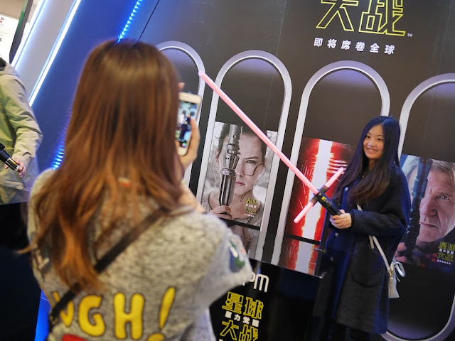 woman posing with a light saber at the IAPM shopping center in Shanghai