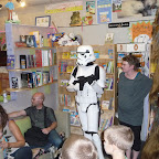 Illustrator Chris Reiff, a Storm trooper, Miss Kelli, and Chewbacca listen author Tom Angleberger