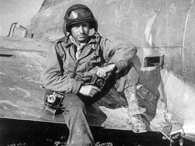 Then-GI Tony Vaccaro on the wing of a B-17 Bomber in 1944.